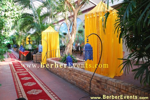 Moroccan Red Carpet, Hanging Moroccan Blue Majorelle Lanterns and Sheer Canopies at The Covered Garden Atrium adjoining the Ballroom